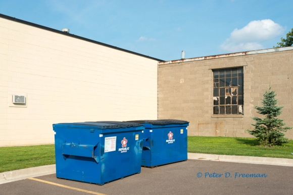 Two Blue Dumpsters